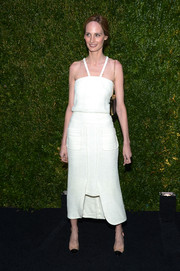 Lauren Santo Domingo paired her dress with stylish PVC cap-toe pumps.