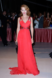 Yvonne's candy apple red flowing gown made a bold statement at the Venice Film Festival.