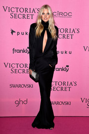 Elsa Hosk complemented her alluring gown with a beaded black-and-white Chanel clutch.