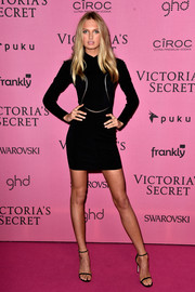 Romee Strijd's little black dress at the Victoria's Secret after-party had a military feel with its long sleeves, high neck, and silver detailing.