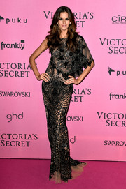 Izabel Goulart chose an asymmetrical, intricately patterned black and nude gown by Zuhair Murad for her Victoria's Secret after-party look.