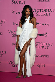 Grace Mahary added a touch of luxury with a white fur stole.