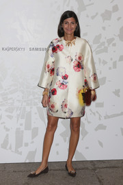 Giovanna Battaglia looked very classy in a vintage-glam floral coat by Giambattista Valli during the Vogue Talents Corner fashion show.