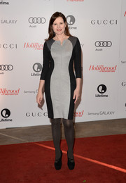 Geena Davis sealed off her look with a pair of precarious-looking black platform pumps.