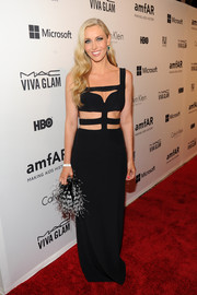 Melanie Lazenby finished off her look in frilly style with a black-and-white feathered clutch.