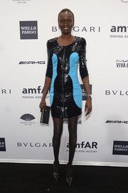 Alek Wek went for modern glamour in a sequined two-tone mini dress during the amfAR New York Gala.