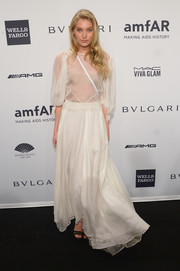 Elsa Hosk looked ethereal in a gauzy white gown during the amfAR New York Gala.