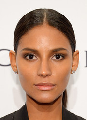 Emanuela De Paula opted for a stark center-parted ponytail when she attended the amfAR New York Gala.