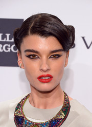 Crystal Renn sealed off her striking beauty look with a swipe of bright red lipstick.