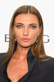 Alina Baikova opted for a sleek center-parted hairstyle when she attended the amfAR New York Gala.
