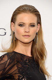 Behati Prinsloo slicked her long hair back for a punk-glam look during the amfAR New York Gala.