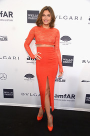 Alyssa Miller completed her monochromatic ensemble with a pair of neon orange platform pumps.