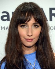 Rebecca Dayan left her hair loose with subtle waves and wispy bangs when she attended the amfAR New York Gala.