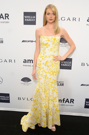 Lindsay Ellingson was a ray of sunshine in a yellow and white printed gown by Wes Gordon during the amfAR New York Gala.