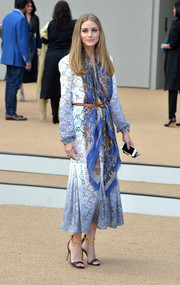 Olivia Palermo styled her dress with a printed scarf, also by Burberry.