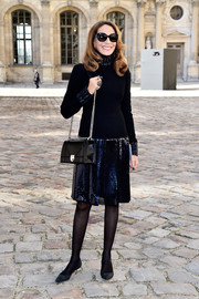 Marisa Berenson kept it laid-back yet glam at the Dior fashion show in a turtleneck LBD with a sequined neckline, cuffs, and skirt.