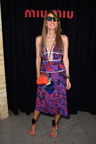 Going all out with the colors, Anna dello Russo accessorized with a bright red mini shoulder bag.