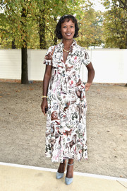 Shala Monroque looked effortlessly chic in a whimsical-print shirtdress during the Valentino fashion show.