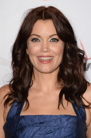 Bellamy Young topped off her look with an ultra-feminine center-parted wavy 'do when she attended the AFI Awards.