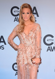 Carrie Underwood went for total shimmer with this metallic gold Jimmy Choo clutch and beaded dress combo at the CMA Awards.