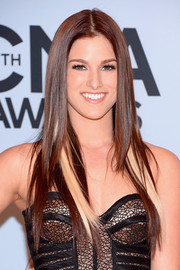 Cassadee Pope wore her hair long and straight with a center part when she attended the CMA Awards.