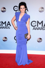 Shawna Thompson looked curvaceous at the CMA Awards in a ruched blue Marc Bouwer mermaid gown with a cleavage-baring neckline.