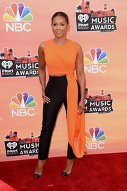 Melanie Brown flashed a bit of abs in an orange and black Roksanda Ilincic jumpsuit at the iHeartRadio Music Awards.