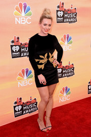 Hilary Duff paired her dress with black and gold skinny-strap sandals by Giuseppe Zanotti.