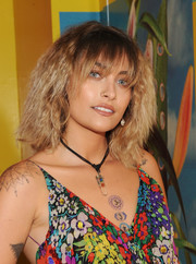 Paris Jackson styled her hair with frizzy waves and wispy bangs for the Art + Commerce: The Exhibition opening.