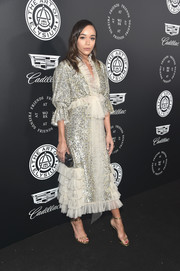 Ashley Madekwe looked totally party-ready in a sequined and ruffled blouse by Rodarte at the Art of Elysium Heaven Gala.
