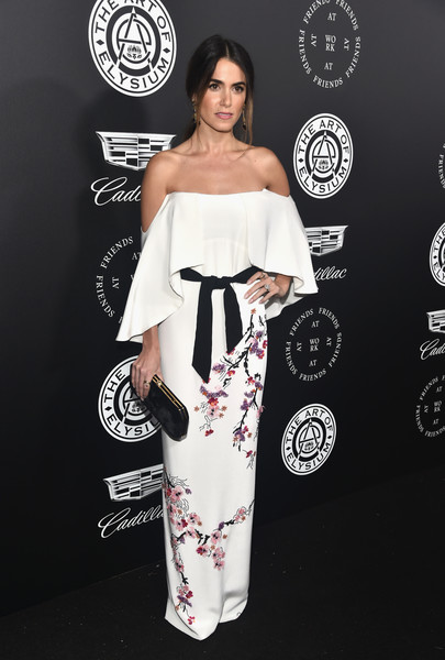 Nikki Reed completed her look with a black velvet clutch by Tyler Ellis.