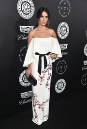 Nikki Reed cut a pretty picture in a white Monique Lhuillier off-the-shoulder dress with a contrast belt and Oriental-inspired floral embroidery at the Art of Elysium Heaven Gala.