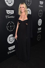 Underneath her coat, Kristin Cavallari was sexy in a black halter gown with side cutouts.