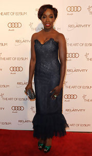 Estelle wore a strapless lace evening dress with emerald heels.