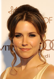 Sophia Bush wore her hair in a sleek formal updo with long spiral tendrils at the Art of Elysium's 5th Annual Heaven Gala.