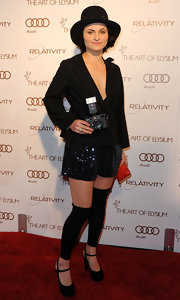 Rain Phoenix looked ready for Cabaret in sequined shorts and a theatrical bowler.