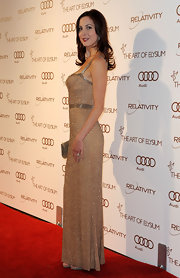 Eva Amurri glittered in a simple gold evening dress for the Art of Elysium Gala.