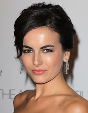 Camilla Belle added some sparkle to her evening look with dangling diamond earrings.