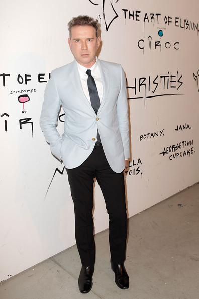 Eugene Sadovoy paired a light blazer with dark slacks for a modern evening look while at the Pieces of Heaven event in LA.