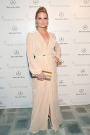 Jennifer Morrison's metallic gold Jimmy Choo clutch and nude evening dress were a very classy pairing.