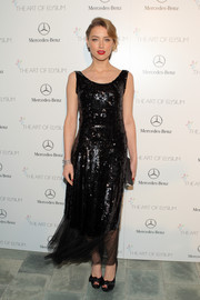 Amber Heard was vintage-chic in a sequined black dress at the Art of Elysium's Heaven Gala.
