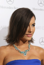 Camilla Belle adorned her bare neckline with a stunning gemstone collar necklace by Van Cleef and Arpels.
