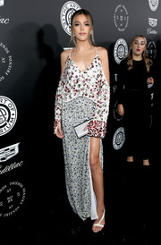 Sistine Stallone completed her look with a pair of white diagonal-strap sandals.