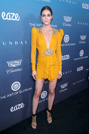 Hilary Rhoda rocked a mustard Dundas mini dress with a plunging neckline and ruffle detailing at the Art of Elysium Heaven celebration.