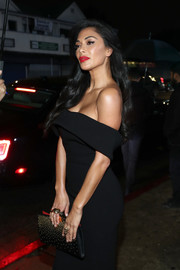 Nicole Scherzinger arrived for the Art of Elysium Heaven celebration carrying a studded black clutch by Alexander McQueen.