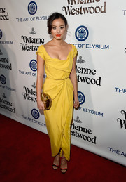 Jamie Chung looked super sophisticated at the Heaven Gala in a draped yellow dress by Vivienne Westwood.