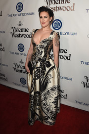 Rumer Willis flashed major cleavage in a low-cut print gown during the Heaven Gala.