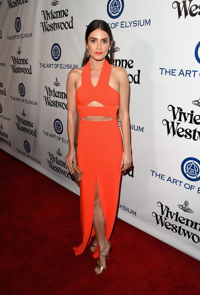 Nikki Reed styled her dress with gold accessories, including a pair of strappy gold heels by Brian Atwood.