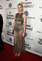 Amber Valletta brought a high dose of sexiness to the Heaven Gala with this sheer metallic gown.