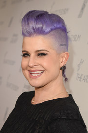 Kelly Osbourne attended the Art of Elysium Heaven Gala rocking her signature purple fauxhawk.